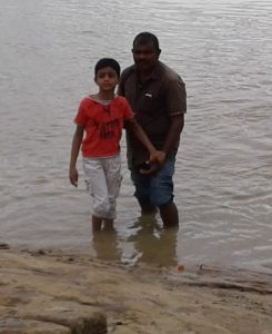 Our domestic driver with my son pic